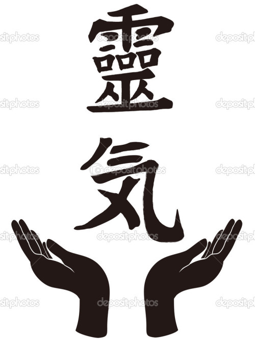 hand holding with the Reiki symbol