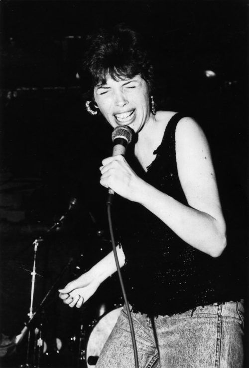 Corina singing at CBGB